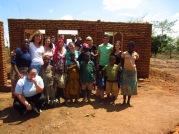The team with Habitat Homeowner Salanawo and her grandchildren