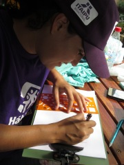 Romina, architecture student sketching designs