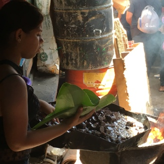 Selling freshly cooked moronga, blood sausage